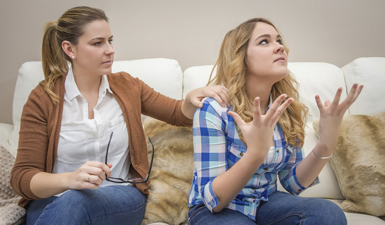 Furious mother arguing with her teenage daughter